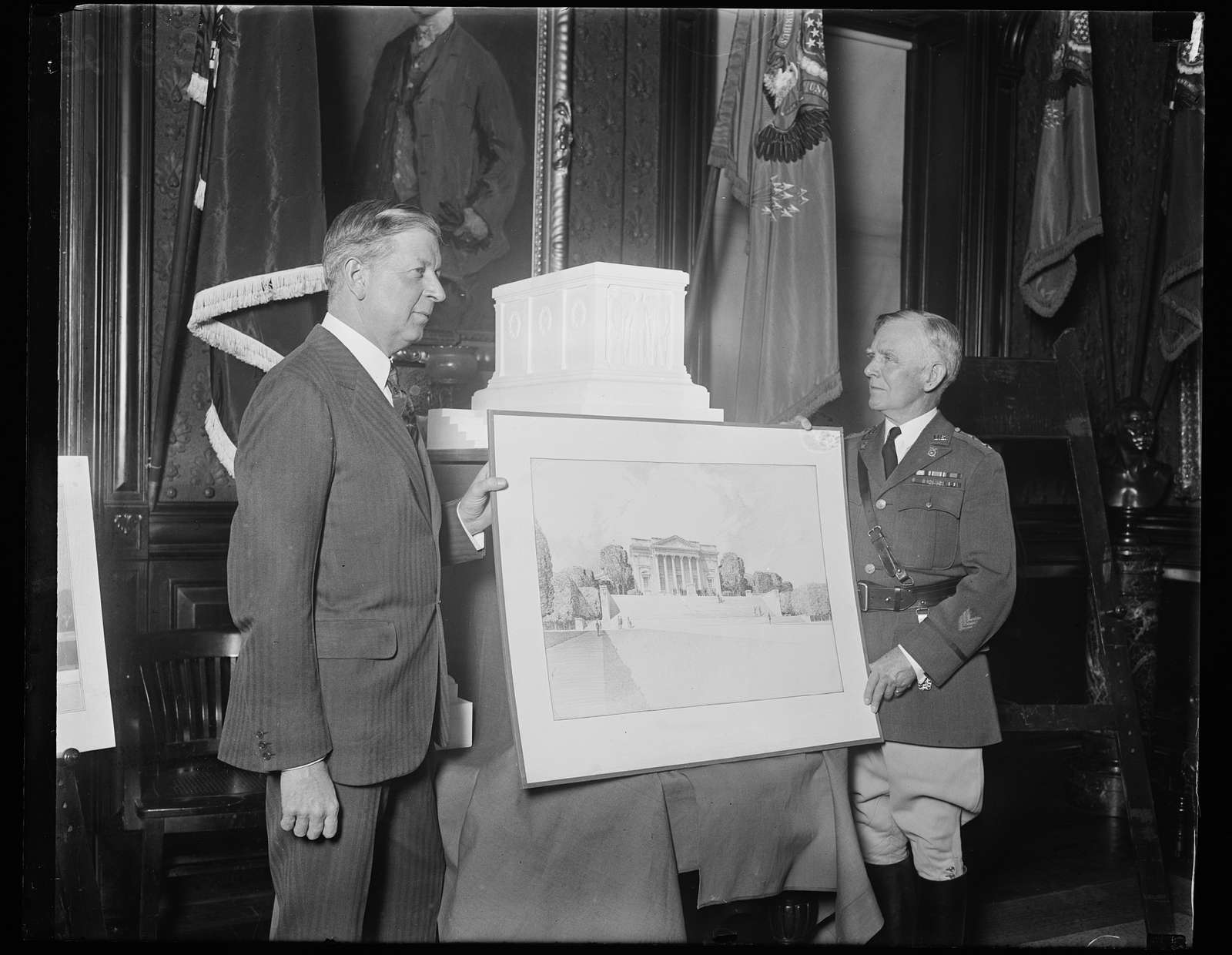 Secretary of War approves of design for Tomb of America's Unknown Soldier. The Secretary of War Dwight F. Davis (left) and Maj. Gen. B.F. Cheatham, Quartermaster General of the United States Army, inspecting the accepted design and model for the completion of the Tomb of the Unknown Soldier in Arlington National Cemetery, which was submitted by Thomas Hudson Jones, sculptor, of New York City; and Lorimer Rich, architect, also of New York City. This design was selected after a competition in which seventy-three designs were submitted