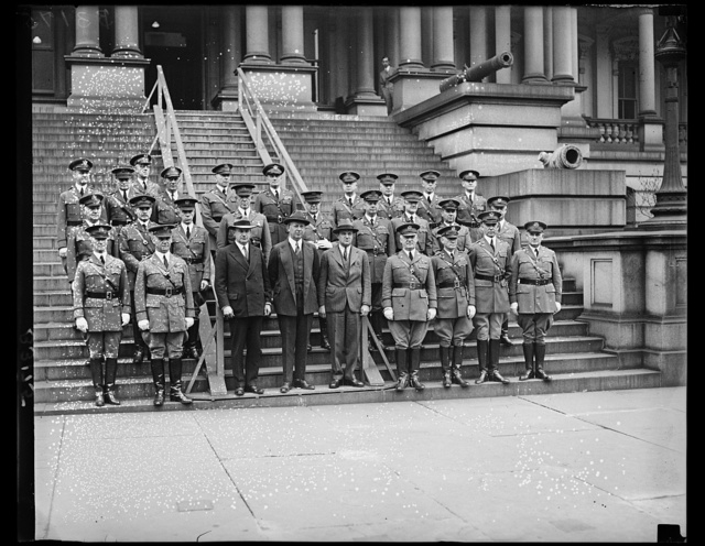 The Secretary of War, The Hon. Dwight Davis, and the Chief of Staff, the Deputy Chief of Staff, the assistants Chief of Staff, and the Chiefs of branches posed for a photograph on the steps of the war Dept. In the group left to right, front row, Major Gen. Frank Parker, Major Gen. Charles P. Summerall, Chief of Staff, Assistant Secretary of War, Col. C.B. Robbins, Secretary of War, Dwight F. Davis, Major Gen, B.H. Wells, Deputy Chief of Staff, Brig. Gen. E.E. Booth, Ass't Chief of Staff, Major Gen. Fred T. Austin, Chief of Field Artillery, Major Gen. A.L. Carmichael, Chief of Finance