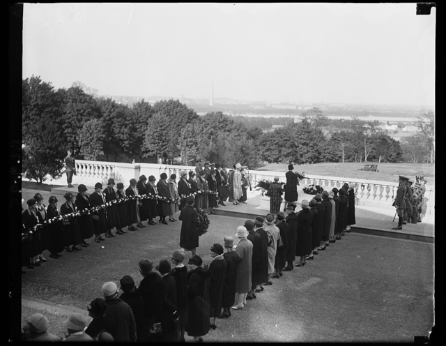 """[...] War mothers placing wreaths on tomb of unknown soldier on Mother's Day. A touching scene at the tomb of America's Unknown soldier today, """"Mother's Day"""" as members [...] the gold star mothers and American War [...] others passed thru a lane of white carnations to place wreaths at the bier of this unknown mother's son"""