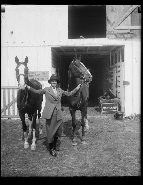 [Wife of New York department store magnate captures first and second prizes at Washington Horse Show. Mrs. Bernard Gimbel, wife of the New York department store magnate, and her horses Capt. Doane (left) and welcome with with whom she captured first and second prizes in the Ladies Hunters class at the National Capital Horse Show today. Capt. Doane is the $12,000 dollar horse who has been capturing many blue ribbons in eastern horse shows recently]