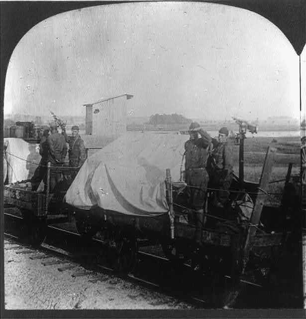 American munition train, protected against air attack by anti-aircraft automatic rifles, going to the front in Meusse-Argonne, 1918