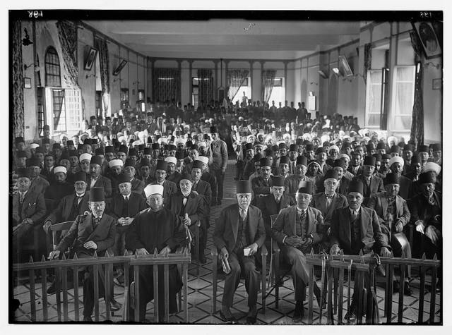 """Arab protest delegations, demonstrations and strikes against British policy in Palestine (subsequent to the foregoing disturbances [1929 riots]). An Arab """"protest gathering"""" in session. In the Rawdat el Maaref hall"""