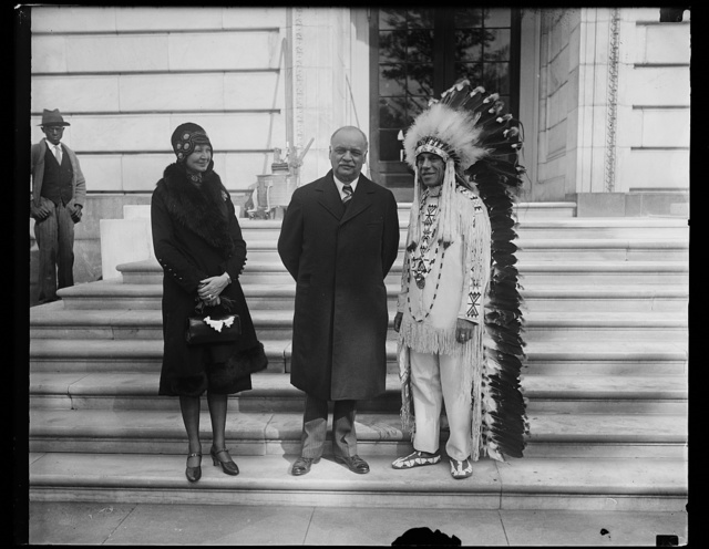 [Charles Curtis, center, and Native American, right]