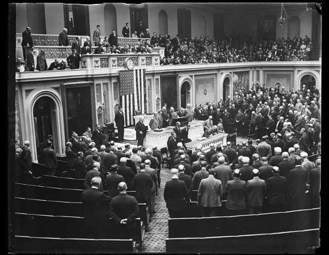 Covering of extra session of Congress, scene in the House of Representatives today when Congress convened for special session called by President Hoover. The chaplain of the House Roy James Shera Montgomery, is shown delivering the opening prayer