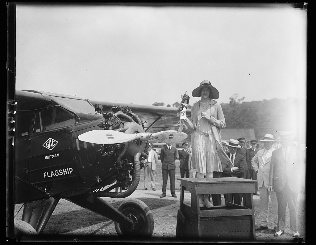 Daughter of Chief of U.S. Army Air Service christens flagship for start of longest air tour ever attempted in history of aviation. Miss Mary Fechet, daughter of Maj. Gen. Fechet, Chief of U.S. Army Air Service, christening the flagship of the eight Aristocrat cabin monoplanes previous to their take-off from Bolling Field, Washington today on 50,000 mile air tour of the United States, Canada, Cuba and Mexico. The tour is being made to demonstrate the practicability of airplane for daily commercial use