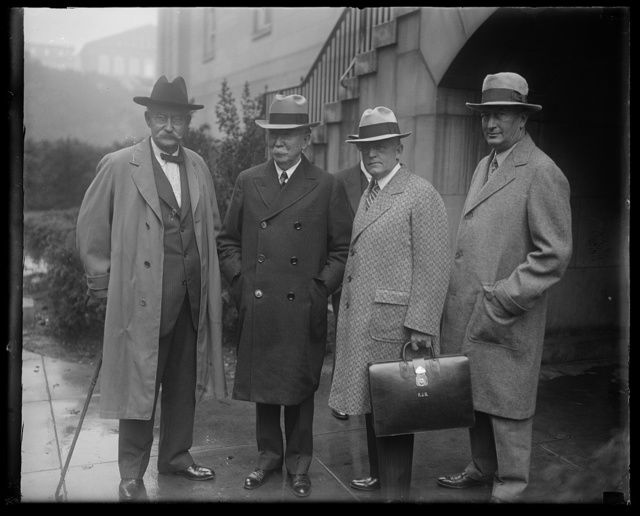 Former Secretary of Interior Fall and Edward Daugherty arraigned in District Supreme Court. Former Secretary of the Interior Albert B. Fall and Edward Doheney, oil magnate, arriving at the District Supreme Court today where they were arraigned for conspiring to defraud the government in connection with oil leases. In the photograph, left to right: Albert E. Fall; Edward Dohoney, Frank J. Hogan, counsel for Doheney; and Mark B. Thompson, counsel for Fall