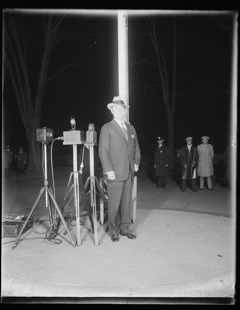 Into the open. Harry F. Sinclair, millionaire oil magnate faced a battery of cameras and flash guns as he stepped, a free man, from the District Jail, shortly after midnight, last night