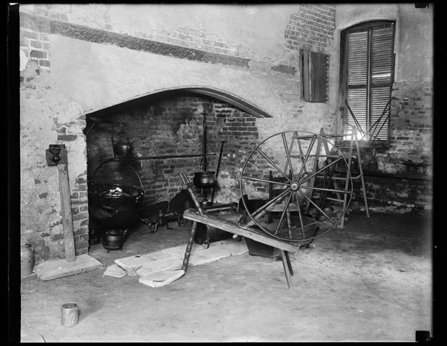 [Large fireplace and spinning wheel, Stratford Hall?, Westmoreland County, Virginia]