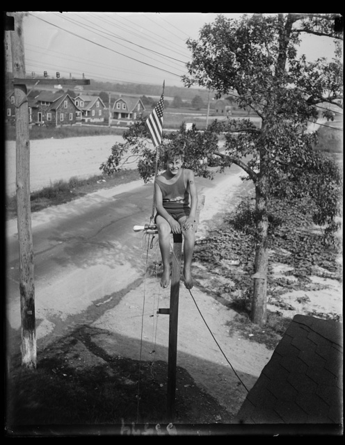 Maryland youth breaks pole sitting record. William Ruppert, 14-year-old youth of Colgate, Maryland, as he appeared atop the flag pole in the yard of his home yesterday after breaking the pole sitting record of 23 days set by Shipwreck Kelly. Young Ruppert who started his sitting on August 1, has worn out three pairs of trousers so far. He says he expects to stay up 30 days more. The pole is 18 feet high