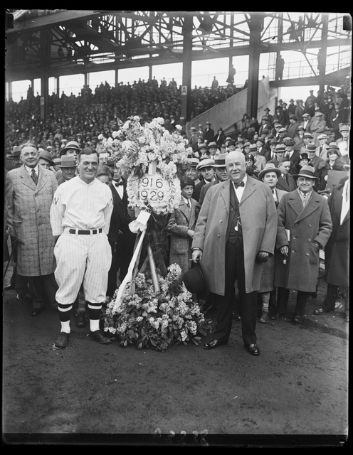 On behalf of the Elks of Washington, Joe Judge, captain of the Washington Baseball Team, was presented with a beautiful floral tribute today by Judge Robert E. Mattingly before the start of the first game