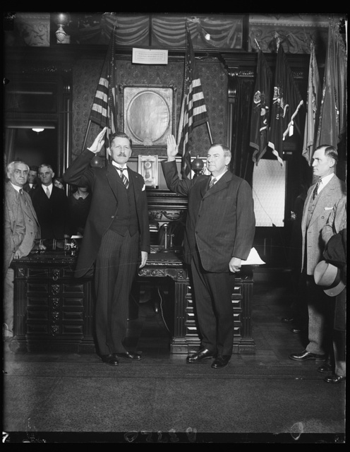 Patrick J. Hurley takes oath of office as Secretary of War to succeed late James V. Good. Justice Harland Fiske Stone (right) Associate Justice of the United States Supreme Court, administering the oath of office to Patrick J. Hurley of Oklahoma, who succeeds the late James V. Good as Secretary of War. The new secretary was formerly Assistant Secretary of War. 12/9/29