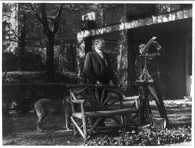 [President Herbert Hoover posed outdoors for talking motion picture]