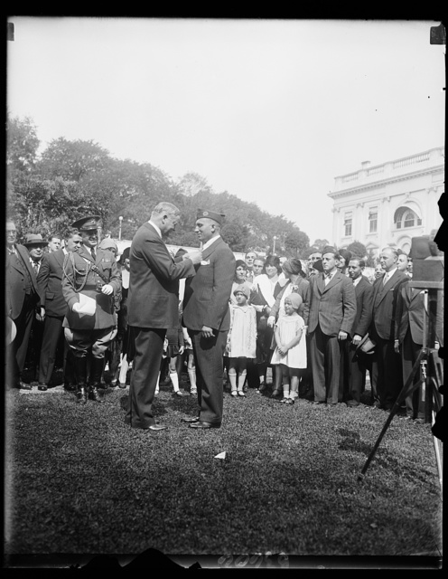 President Hoover presents Congressional Medal of Honor to World War hero. Michael Valente, formerly Private, Company D, 107th infantry, 27th Division during the World War, receiving from President Hoover the Congressional Medal of Honor at the White House today. Valente receives the medal for bravery while in Hindenberg Line during the World War. He enlisted at Ogdensburg, N.Y., but is now a resident of Long Beach, N.Y.