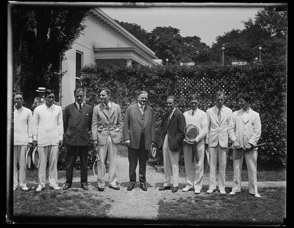 President receives member of American and Japanese Davis Cup teams at White House. Members of the American and Japanese Davis Cup teams, who competing in Washington, were received by President Hoover at the White House today. Left to right: (center) John Hennessey of U.S. Team; President Hoover; and F.E. Dixon, Captain of the American team