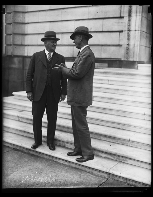 Representative Willis G. Hawley of Oregon, left, and Senator [...] Smoot, authors of the Tariff Revision Bill shown on the steps of the Senate Office building