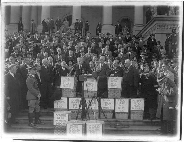 Sen. Smoot and Rep. Hawley on the steps of the Capitol addressing a large gathering who presented petitions for tax reductions