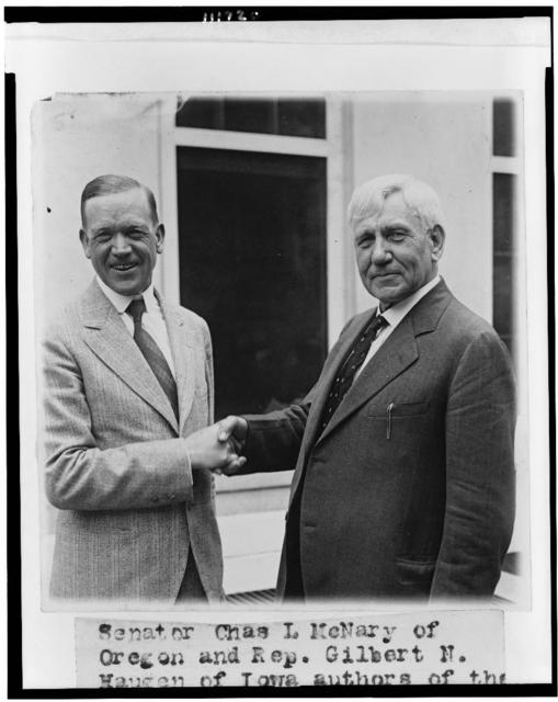 [Senator Charles L. McNary and Rep. Gilbert N. Haugen, half-length portrait, standing at the White House, shaking hands]