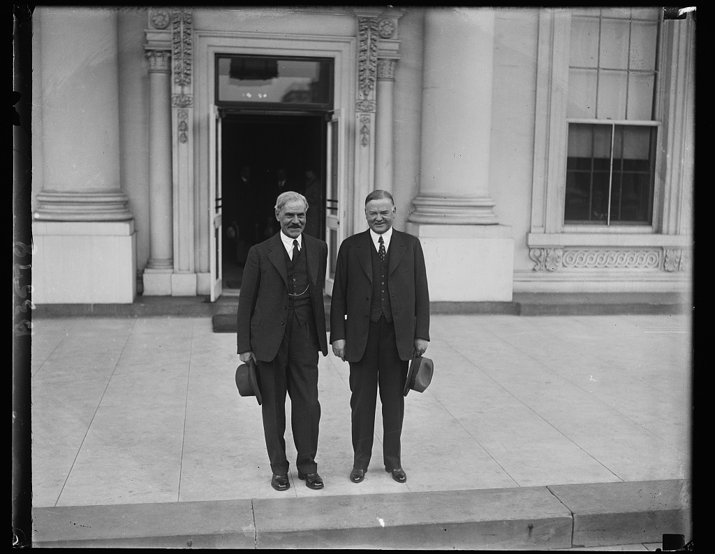 The big duo. Just before leaving for the presidential camp on the Rapidan, President Hoover and Premier MacDonald posed for this picture on the front steps of the White House