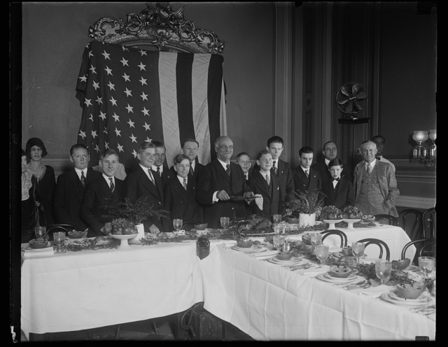 [Vice-president Curtis entertains pages. One of the yuletide events the pages of the Senate look forward to with anticipation is the annual dinner given for them by Vice-President Charles Curtis. The photograph shows the pages at this year's party, with their genial host about to carve the turkey]