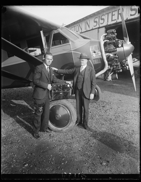 Washington inventor says ignition interference from airplane engines is a myth. Ignition interference from airplane engines on aircraft is largely a myth according to C. Francis Jenkins, Washington, D.C., inventor who has designed a radio receiving set which he does not pick up noises from a flying power plant. In this photograph is shown Mr. Jenkins (right) and his laboratory assistant