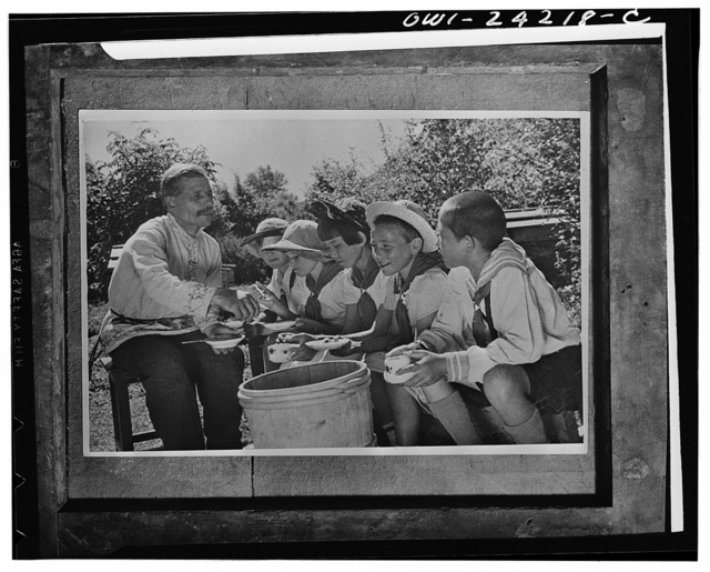Altai territory, Central Asia, USSR (Union of Soviet Socialist Republics). Children on a collective farm tasting honey
