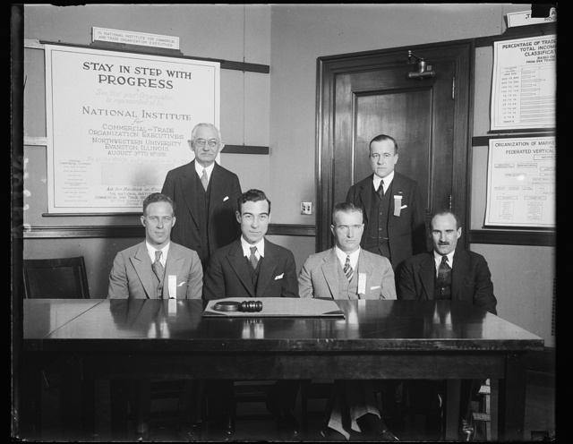 "Aviation leaders plan uniform laws. Leaders in the field of aviation from all over the country met in Washington today for the National Conference on Uniform Aeronautic Regulatory Laws. Maj. Clarence M. Young, Assistant Secretary of Commerce for Aviation, acted as chairman of the sessions. In the photograph, left to right, seated: Capt. Frank M. Hawks, noted speed flyer and glider pilot; Maj. Young; Alfred J. Williams, former Navy speed ace, and Charles S. (""Casey"") Jones, famous pilot and vice-president of the Curtiss-Wright Corporation. Standing: W.S.Mayo, chief aeronautical engineer of the Ford Company, and State Senator J. Griswold Webb, chairman of the New York State Aviation Commission. 12/16/30"
