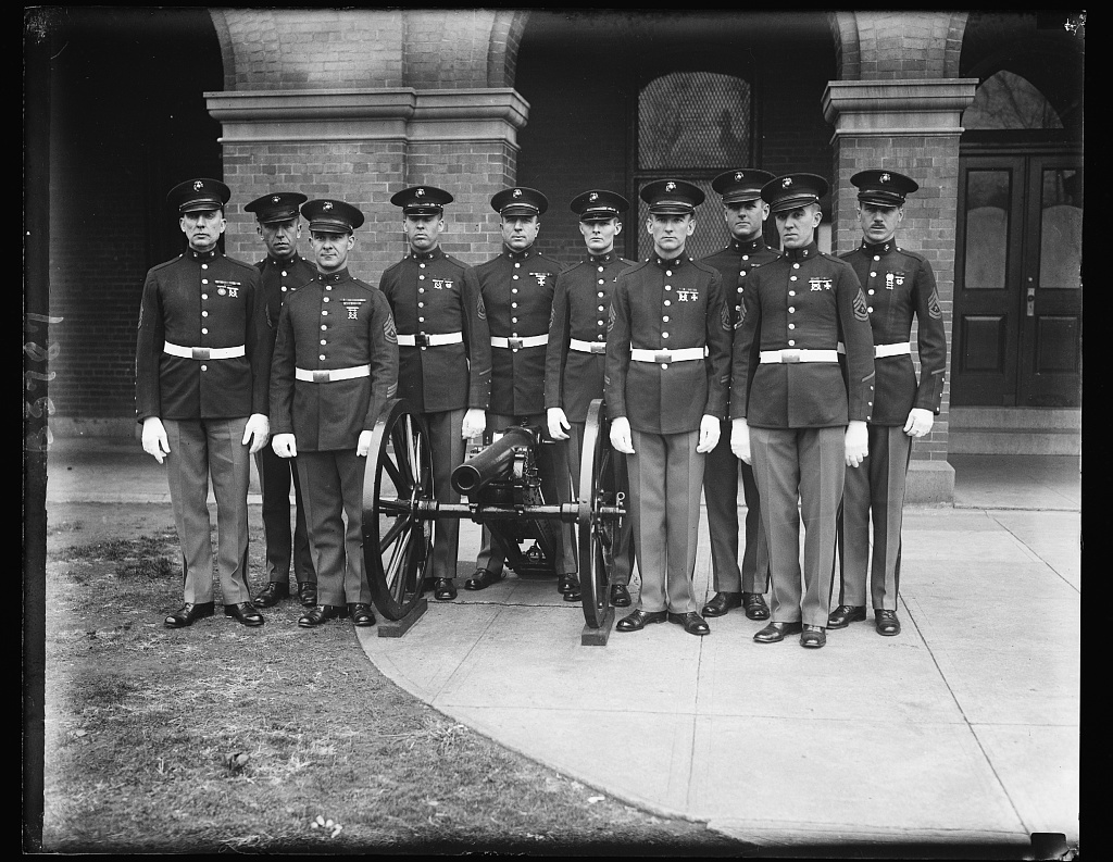 Conference couriers. These ten crack sergeants of the United States Marine Corps will act as couriers for the American delegation to the London Armament Conference. They are, left to right: Maddox and J.S. Domzaksi. Back row: (left to right) J.G.Mason, M.P.Clary, Charles W. Harriman, F.L. Brauer, J.M. Rice and W.H. Freeman