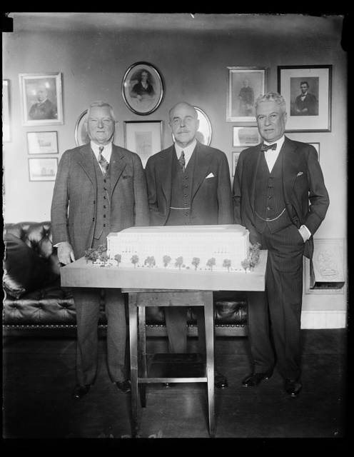 Congressmen plan new quarters. Perhaps these three House leaders were planning the locations of their new offices as they looked over the model of the new House office building. But they will have a long wait before moving in, as work on the $22,000,000 building has just begun. Left to right: Rep. J. M. Garner of Texas, House Minority leader; Speaker Nicholas Longworth, and Rep. Isaac Bacherach of New Jersey, members of the House Office Building Commission. 11/29/30