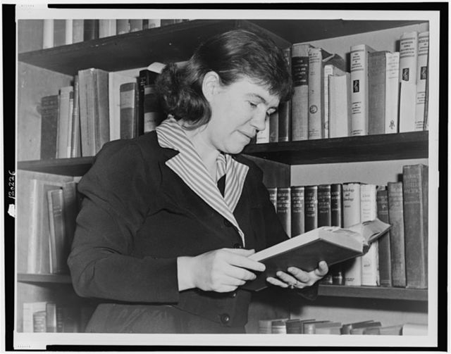 [Dr. Margaret Mead, half-length portrait, facing right, reading book] / World-Telegram photo by Edward Lynch.