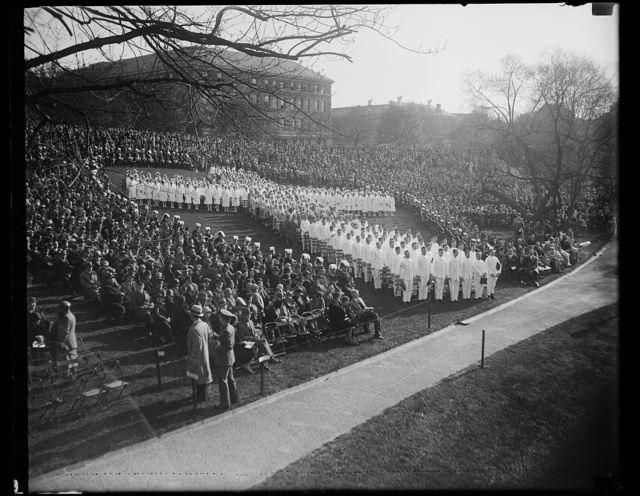 Easter sunrise services at Walter Reed Hospital in Washington. Scene at Walter Reed Hospital [...] Easter Sunday, at the Sunrise services. Nurses and orderlies at the hospital formed this human cross
