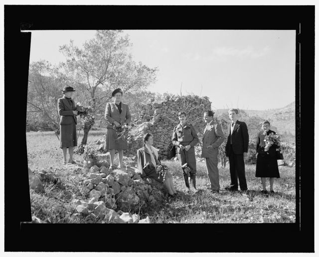 [Edith Matson (second from left) with men and women near a stone structure, possibly a watch tower, Palestine]