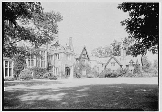 F. Eugene Dixon, residence in Elkins Park, Pennsylvania. Entrance facade through trees, from left