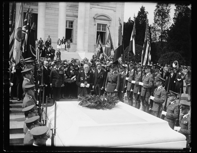 Foreign veterans honor unknown dead. One of the first acts of the delegates of the Federation Interallies des Ancians Combattants [...] upon their arrival in Washington for their eleventh annual convention was to make a pilgrmage to Arlington National Cemetary to pay tribute to the Unknown dead of the World War. This photograph shows Lieut. Col. Fred Abbott of England, president of Fidae, placing a medal on the Unknown Soldier's Tomb, after first laying a wreath there