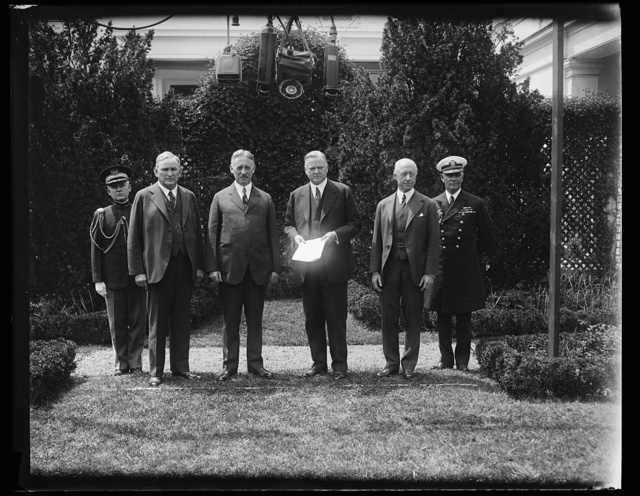 [Group, including Henry Stimson, 3rd from left, Herbert Hoover, center, and Charles Adams, 2nd from right]