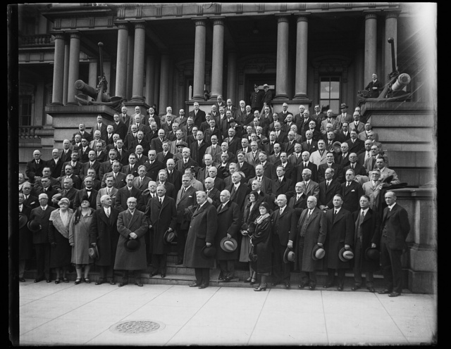 [Herbert Hoover and group on steps of State, War and Navy Building, Washington, D.C.]