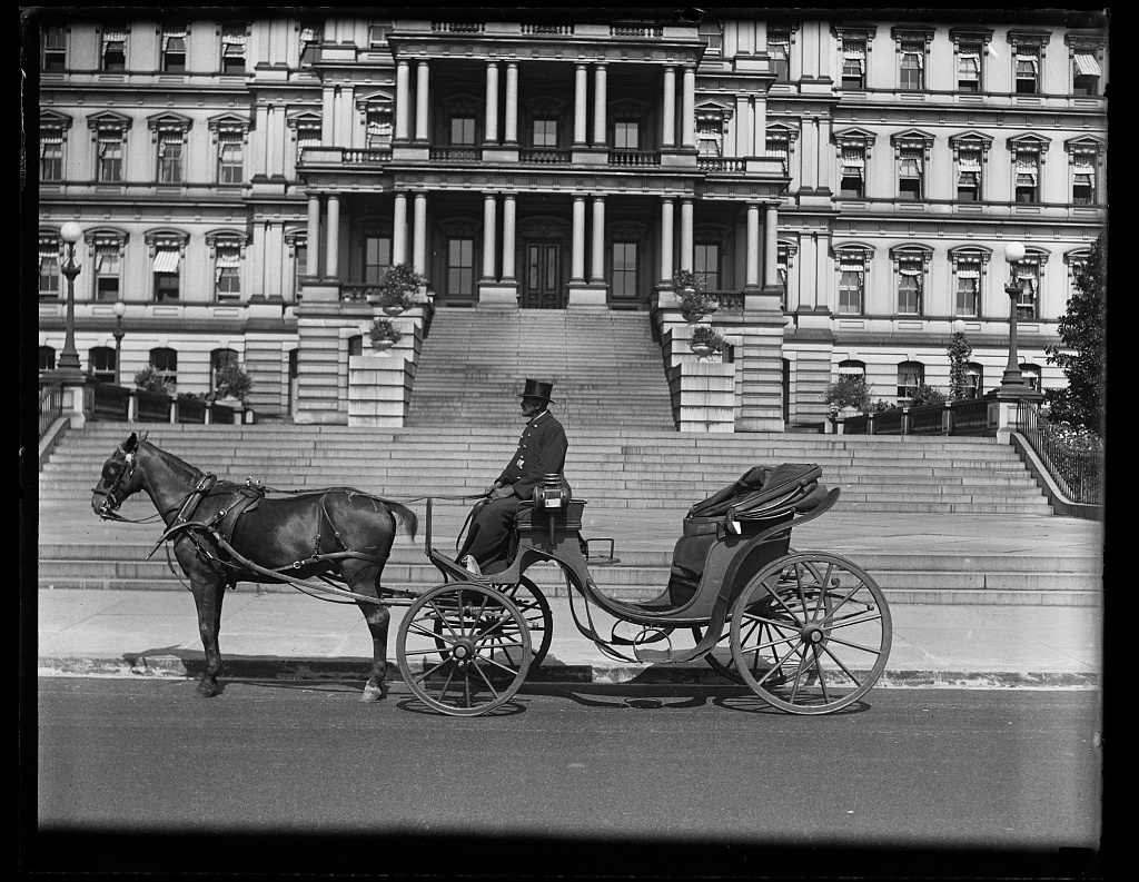 [Horse drawn carriage in front of State, War, and Navy Building, Washington, D.C.]
