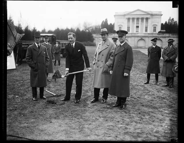 Hurley inaugurates construction work at tomb of unknown soldier. Secretary of War Patrick J. Hurley broke the ground to start construction of approaches to the Tomb of the Unknown Soldier at Arlington National Cemetary. Plans for the work were selected as the result of a nationwide competition and the $416,000 project was begun at this time for the purpose of relieving unemployment in the vicinity of Washington, Left to right in the photograph: Col. Arthur Woods, chairman of President Hoover's Committee on unemployment; Secretary Hurley; Gen. Douglas MacArthur, new chief of staff of the U.S. Army, and Maj. Gen. J.L.DeWitt, quarter-master general. 12/19/30