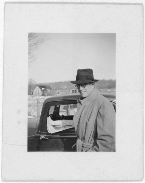 [John Avery Lomax, Jr. standing next to car, looking left]