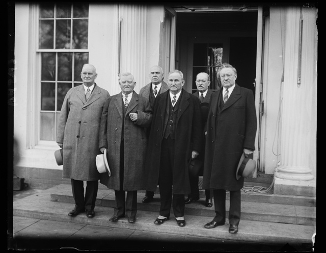 Just an old congressional custom. One of the old customs in connection with the opening of Congress is to send a joint committee to the president to inform him that Congress has convened. The photograph shows the delegation at the White House following the convening of the present session. Front row, left to right; Rep. Willis C. Hawley; Rep. John N. Garner, House minority leader; Sen. Joseph T. Robinson and Sen. James E. Watson. Back row; William Tyler Page, chief clerk of the House, and David S. Barry, Sergeant-of-Arms of the Senate. 12/3/30