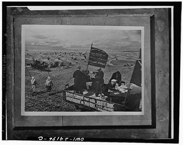 "Kiev (vicinity), Ukraine, USSR (Union of Soviet Socialist Republics). Settin uo the district newspaper, ""Collective Farmer"" in the fields of a farm"