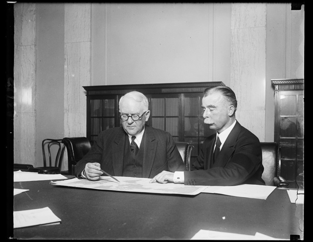 MacKay testifies in wire quiz. Senator James Couzens (left) of Michigan, Chairman of the Senate Interstate Commerce Committee and Clarence M. MacKay, President of the Postal Telegraph-Cable Company looking over a map in connection with the proposed Federal commission to regulate American communication systems. Mr. Mackay said that he was in favor of the establishment of such a commission