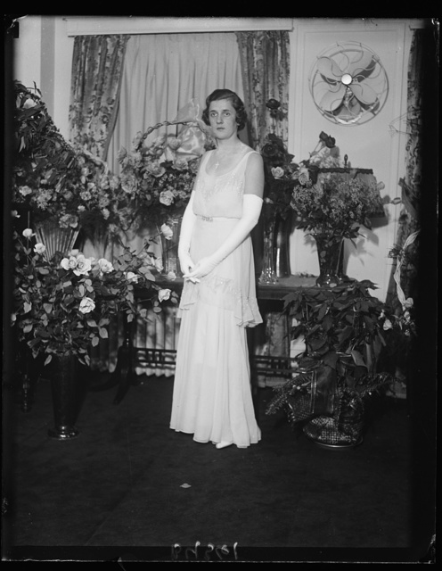 Makes Capital debut at lavish ball. Miss Helen [...] Eames Doherty, photographed during her debut in Washington, a function of rare proportions even in the cosmopolitan capital. Many members of the diplomatic corps and other notables were included among the 1,000 guests. The entire first floor of the Mayflower Hotel, with its several ball rooms, was reserved for the occasion and the lavish entertainment included radio celebrities and a 22-piece orchestra. Miss Doherty is the daughter of Mr. and Mrs. Henry J. Doherty of New York