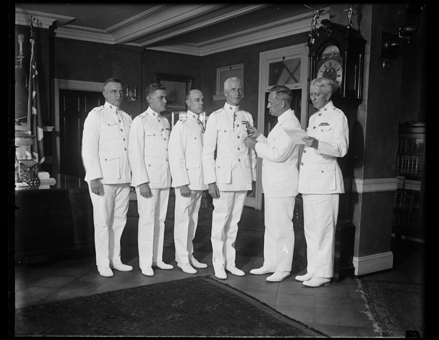 Marines receive decorations. Four officers of the United States Marine Corps were decorated with the Navy Corps today for distinguished services in Nicaragua. The [...] reading from left to right, were: Lieut. Edwin U. Hakala of Detroit, Mich.; Captain William R. McNulty of Antrim, Pa.; Major Miles R. Thaer of Fort Niobararo, Neb.; and Col. James T. Buttrick of Newport, R.I., who is receiving the model from Assistant Secretary of the Navy. Jahnke, while Maj. Gen. Ben H. Fuller, Commandant of the Marine Corps, reads the citation