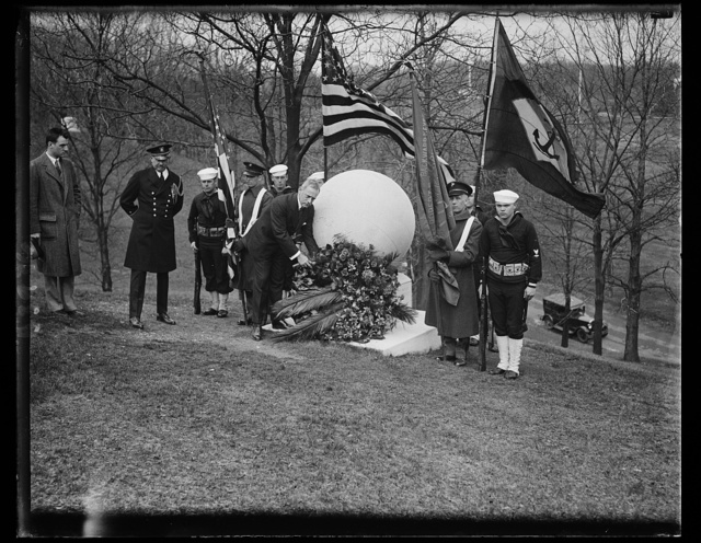 Navy honors twenty-first anniversary of discovery of North Pole by Admiral Peary. Today was the twenty-first anniversary of the discovery of the North Pole by Admiral Robert E. Peary and fitting exercises were held at the Peary tomb in Arlington National Cemetary to commemorate the event. Assistant Secretary of the Navy Ernest Lee Jahnke, is shown placing a wreath