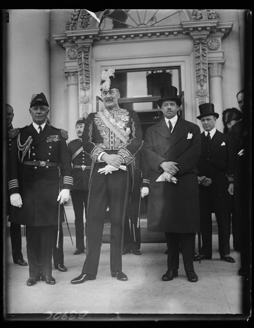 New British Ambassador presents credentials to President Hoover at White House. Sir Ronald Lindsay, who recently arrived in Washington to replace Sir Esme Howard as Ambassador from Great Britain, presented his letters of credence to President Hoover at the White House today. In the photograph, left to right: Capt. Allen Buchannan, White House Naval aide; Sir Ronald Lindsay; and Francis White, Assistant Secretary of State