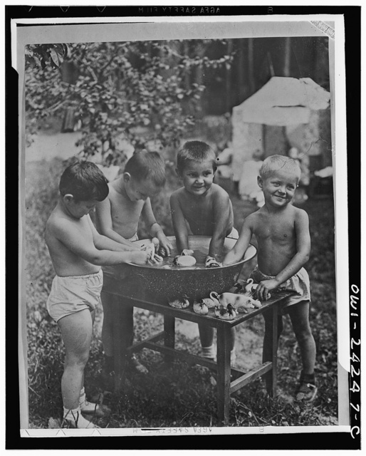 Nursery school children playing with a tub of water in the USSR (Union of Soviet Socialist Republics)