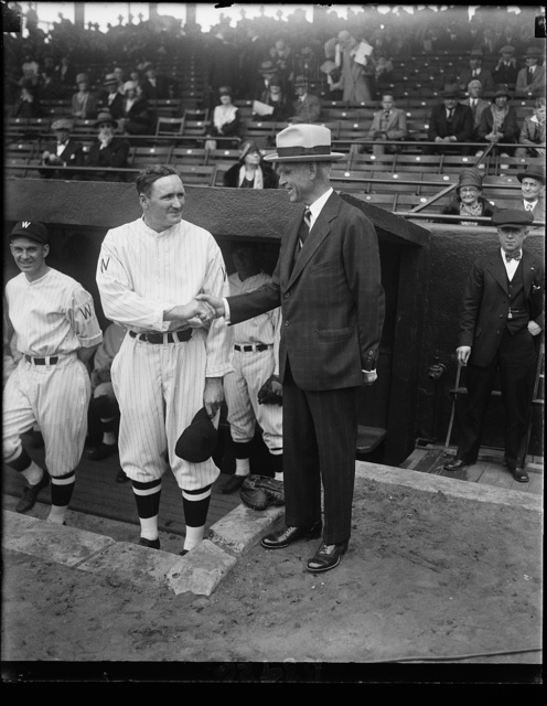 """Old Fox"" wishes ""Big Train"" luck on opening of 1930 season. Clark Griffith, president of the Wash. Baseball Club, wishes the best of luck to Walter Johnson, manager of the team, just before the opening game today between Washington and Boston"