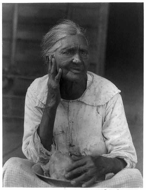 [Old woman holding a bowl]