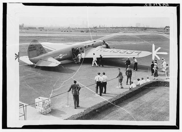 Passengers boarding monoplane