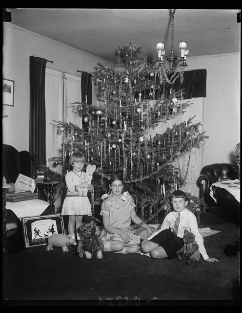 Perhaps the Rhineland grows bigger yule trees than this one, but these German kiddies are quite happy with the American product. They are Adelaide, Hubert and Charlotte, children of Rudolph Leitner, First Secretary of the German Embassy, and Mrs. Leitner